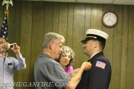 Chief Gravius's Badge Being Pinned by Fire Commissioner Chris Gravius (father)