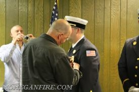 Lieutenant Innes's Badge Being Pinned by His Father
