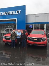 LMFD Fire Commissioners Jim Seymour (L) and Chris Gravius (R) Accept Delivery From DeNooyer Chevrolet Salesman Bill Asprion (center) On 3/31/17